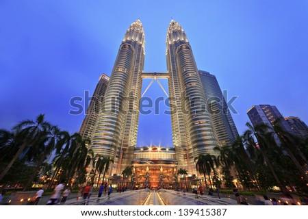 KUALA LUMPUR, MALAYSIA - APRIL 13: Nightscape of Petronas Twin Towers on April 13, 2013 in Kuala Lumpur Malaysia. Petronas Twin Towers were the tallest buildings (452m) in the world during 1998-2004. - stock photo