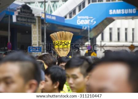 Kuala Lumpur, Malaysia 30 August 2015 : Bersih4 broom held up at Bersih 4 Rally for Free Fair Elections. Bersih organized Rallies 29/30 August 2015 in cities around Malaysia - stock photo