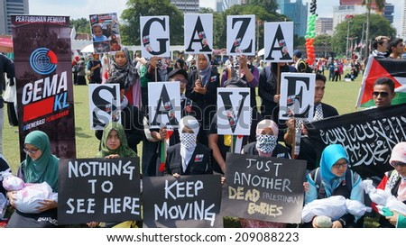Kuala Lumpur, Malaysia - August, 2: People protest against Gaza strip bombing  during the pro-Palestine rally in Kuala Lumpur, August 2, 2014. - stock photo