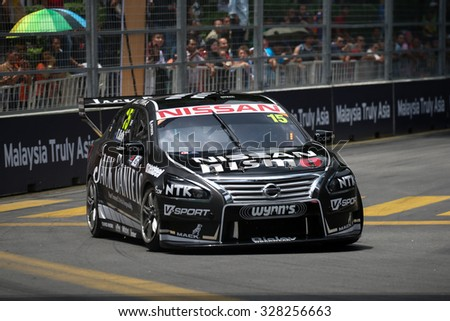 KUALA LUMPUR, MALAYSIA - AUGUST 08, 2015: Todd Kelly from the Nissan Motorsports team races in the V8 Supercars Street Challenge at the 2015 Kuala Lumpur City Grand Prix. - stock photo