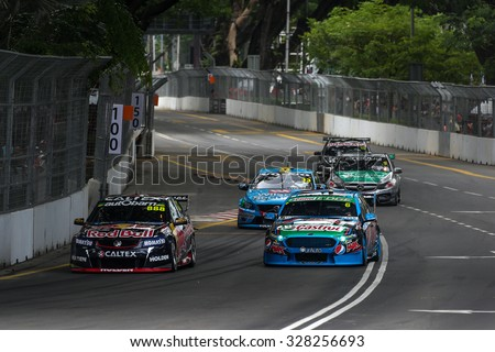 KUALA LUMPUR, MALAYSIA - AUGUST 08, 2015: Turbo charged V8 supercars take part in the V8 Supercars Street Challenge at the 2015 Kuala Lumpur City Grand Prix. - stock photo