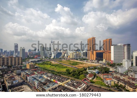 Kuala Lumpur Malaysia Central Cityscape with Old Neighborhood Houses Against Cloudy Blue Sky - stock photo