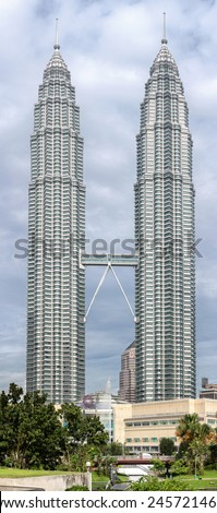 KUALA LUMPUR, MALAYSIA - DECEMBER 27, 2014: High quality picture of The Petronas Twin Towers, the world's tallest twin towers. The skyscraper height is 452m.  - stock photo