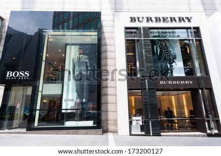 KUALA LUMPUR, MALAYSIA - DECEMBER 26: Hugo Boss and Burberry stores at the Pavilion shopping mall in Bukit Bintang. Photo taken December 26, 2013 in Kuala Lumpur, Malaysia. - stock photo