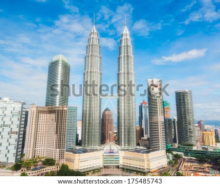 KUALA LUMPUR, MALAYSIA - DECEMBER 28: The skyscrapers of central Kuala Lumpur, with the Petronas Towers figured prominently. Photo taken December 28, 2013 in Kuala Lumpur, Malaysia. - stock photo