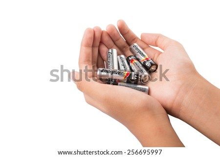KUALA LUMPUR, MALAYSIA - FEBRUARY 27TH 2015. Hand holding used Energizer AA batteries. Energizer Holdings is an American manufacturer of batteries and are sold in over 165 countries worldwide. - stock photo