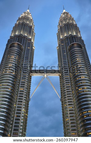 KUALA LUMPUR, MALAYSIA - FEBRUARY 21, 2014: The Petronas Towers are twin skyscrapers. They were the tallest buildings in the world from 1998 to 2004 and remain the tallest twin towers in the world. - stock photo