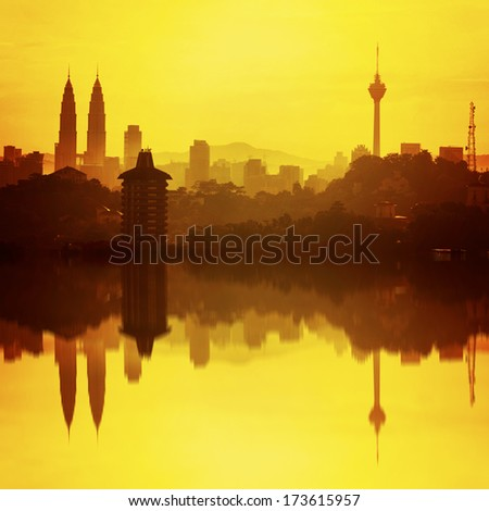 Kuala Lumpur , Malaysia highest skyscraper and the reflection during sunrise. - stock photo