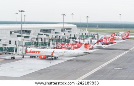 Kuala Lumpur, Malaysia - January 5, 2015. Aircraft of Lion air and Air asia are parking and preparing to flying at Kuala Lumpur International Airport on Jan 5, 2015 - stock photo