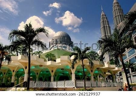 Kuala Lumpur, Malaysia - January 1, 2008:  Islamic Masjid Asy-Syakirin Mosque and the twin Petronas Towers - stock photo