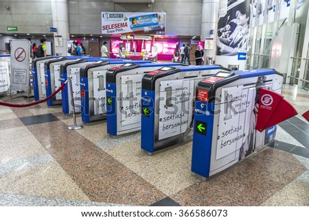 KUALA LUMPUR, MALAYSIA - JANUARY 10, 2016: People at KL Sentral Station exit. KL Sentral is a major transport hub of Kuala Lumpur opened in 2001.  - stock photo