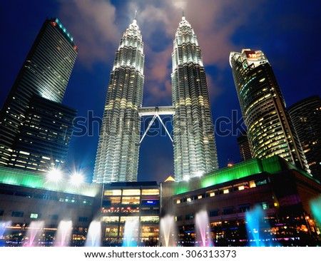 KUALA LUMPUR, MALAYSIA - JANUARY 9: Petronas Twin Towers at day on January 9, 2014 in Kuala Lumpur. Petronas Twin Towers were the tallest buildings (452 m) in world from 1998 to 2004 - stock photo