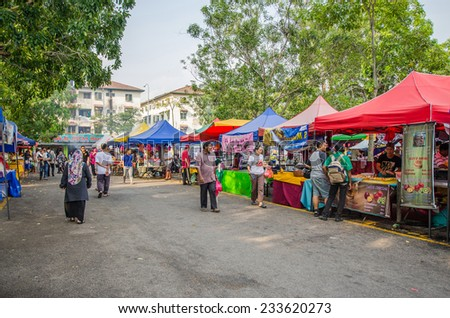 Kuala Lumpur,Malaysia - July 23, 2014: People seen walking and buying foods around the Ramadan Bazaar.It is established for muslim to break fast during the holy month of Ramadan. - stock photo