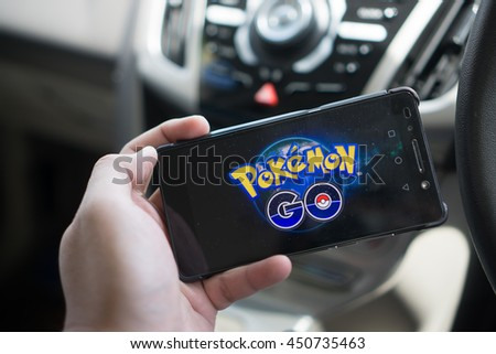 KUALA LUMPUR, MALAYSIA - JULY 9TH, 2016 : An Android user plays Pokemon Go in a car, a free-to-play augmented reality mobile game developed by Niantic for iOS and Android devices. - stock photo