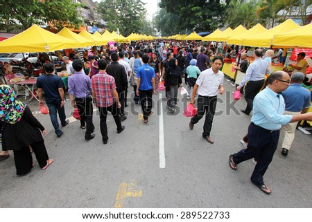 KUALA LUMPUR, MALAYSIA : JUNE 18, 2015 - A crowd at a ramadhan bazaar during the fasting month of ramadhan - stock photo