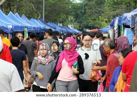 KUALA LUMPUR, MALAYSIA : JUNE 20, 2015 - Crowd buying food at a ramadhan bazaar before breaking fast during the fasting month of ramadhan. - stock photo