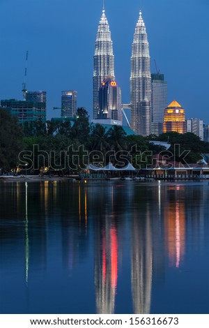 KUALA LUMPUR, MALAYSIA - JUNE 19: Petronas Twin Towers in twilight on June 19, 2011 in Kuala Lumpur. They were the tallest building in the world 1998-2004 and remain the tallest twin building - stock photo