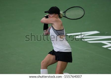 Kuala Lumpur, Malaysia, March 02 2013: American Bethanie Mattek-Sands returns a shot to Czech Karolina Pliskova during the final match of the WTA Malaysian Open tennis tournament - stock photo