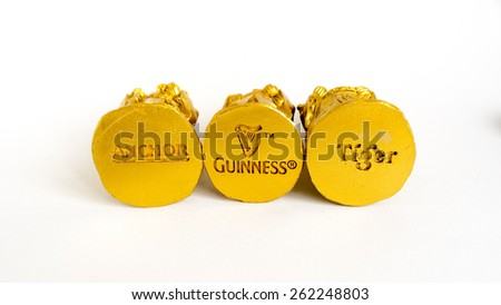 Kuala Lumpur, Malaysia - March 21, 2015 : Anchor beer, Guinness beer and Tiger beer logo on the base plate of golden statue. All of these brand is among the most successful beer brands worldwide. - stock photo