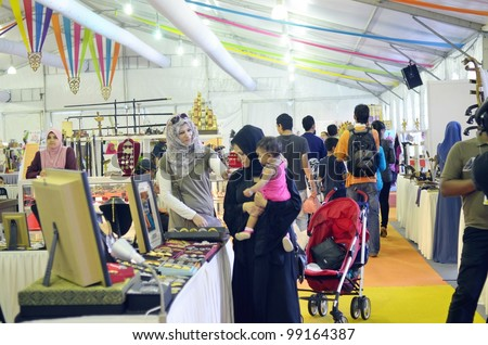KUALA LUMPUR, MALAYSIA - MARCH 30: Goods and souvenirs sold by exhibitors during the exhibition of the National Craft Day 2012 at the Kuala Lumpur Craft Complex on March 30, 2012 in Kuala Lumpur - stock photo