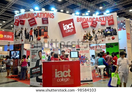 KUALA LUMPUR, MALAYSIA - MARCH 17: IACT College promote the exhibition during the Falcon Education Fair 2012 at Kuala Lumpur Convention Centre (KLCC) March 17, 2010 in Kuala Lumpur. - stock photo
