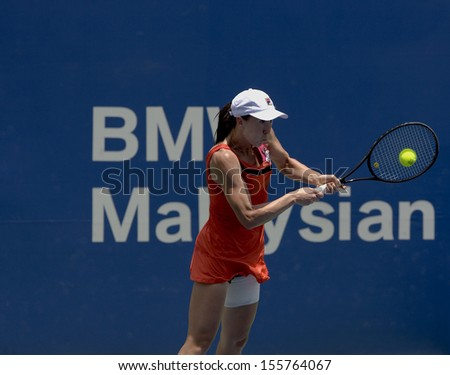 Kuala Lumpur, Malaysia, March 02 2013: Jelena Jankovic of Serbia returns a shot during the semi final match against Petra Martic of Croatia at the WTA Malaysian Open tennis tournament. - stock photo