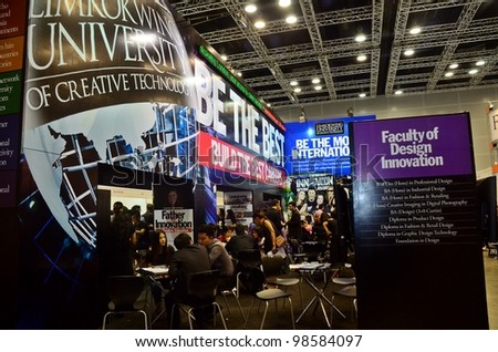 KUALA LUMPUR, MALAYSIA - MARCH 17: Limkokwing University promote the exhibition during the Falcon Education Fair 2012 at Kuala Lumpur Convention Centre (KLCC) March 17, 2010 in Kuala Lumpur. - stock photo