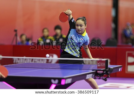 KUALA LUMPUR, MALAYSIA - MARCH 01, 2016: Mima Ito of Japan plays return shot in her match in the Perfect 2016 World Team Table-tennis Championships held in Kuala Lumpur, Malaysia. - stock photo