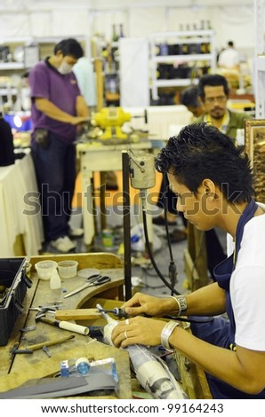 KUALA LUMPUR, MALAYSIA - MARCH 30: Production carving detail by exhibitors during the exhibition at the National Craft Day 2012 at the Kuala Lumpur Craft Complex on March 30, 2012 in Kuala Lumpur - stock photo