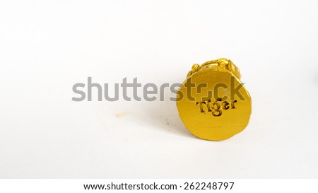 Kuala Lumpur, Malaysia - March 21, 2015 : Tiger beer logo on the base plate of golden statue. Launched in 1932, Tiger beer became Singapore's first locally brewed beer. - stock photo