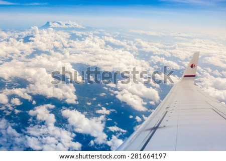 KUALA LUMPUR, MALAYSIA - MAY 25 , 2015 : Malaysia Airlines Boeing 737-800 flying over Malaysian sky. Malaysia Airlines is a government-owned flag carrier of Malaysia. - stock photo
