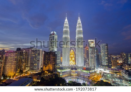 KUALA LUMPUR, MALAYSIA - MAY 19: Petronas Twin Towers at twilight on May 19, 2012 in Kuala Lumpur. Petronas Twin Towers are twin skyscrapers and were tallest buildings in the world from 1998 to 2004. - stock photo