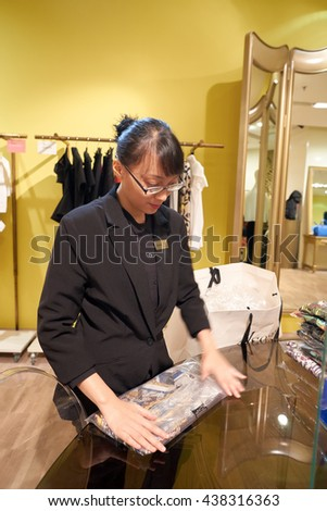 KUALA LUMPUR, MALAYSIA - MAY 09, 2016: portrait of worker in the store at Suria KLCC. Suria KLCC is a shopping mall is located in the Kuala Lumpur City Centre district. - stock photo