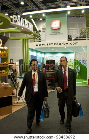 KUALA LUMPUR, MALAYSIA - MEI 19 : Investor walked pass the Pakistan and Sime Darby exhibition booth during the 6th World Islamic Economic Forum (WIEF) Mei 19, 2010 in Kuala Lumpur Malaysia. - stock photo