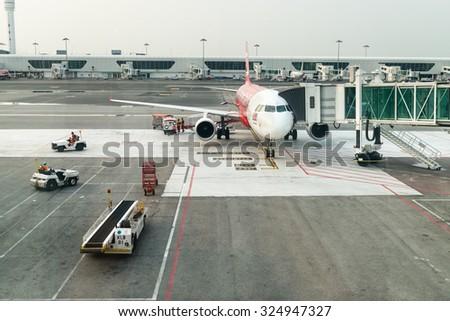 KUALA LUMPUR, MALAYSIA - 02 NOV 2014: Airasia airplane in KLIA 2 airport. KLIA 2 is the low-cost carrier terminal at Malaysia's main international airport KLIA. - stock photo