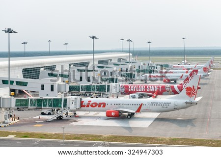 KUALA LUMPUR, MALAYSIA - 02 NOV 2014: Airplanes in KLIA 2 airport. KLIA 2 is the low-cost carrier terminal at Malaysia's main international airport KLIA. - stock photo
