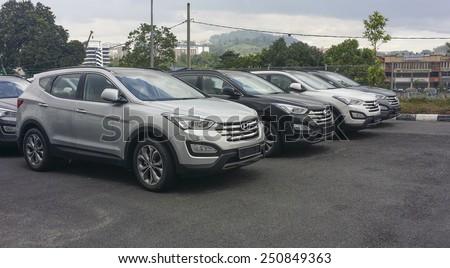 KUALA LUMPUR, MALAYSIA - NOVEMBER 16, 2014 : Hyundai Santa Fe 2014 on display at a local car dealer in Kuala Lumpur, Malaysia. Hyundai Motor Company is based in Seoul, South Korea. - stock photo