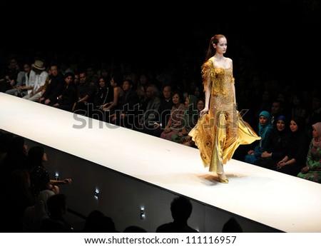 KUALA LUMPUR, MALAYSIA - NOVEMBER 8: Model presents creation by Amir Luqman during Malaysia-International Fashion Week on November 8, 2009 in Kuala Lumpur, Malaysia. - stock photo