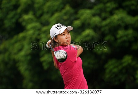 KUALA LUMPUR, MALAYSIA - OCTOBER 10, 2015:Australia's Minjee Lee tees off at the sixth hole of the KL Golf & Country Club on Round 3 day at the 2015 Sime Darby LPGA Malaysia golf tournament. - stock photo
