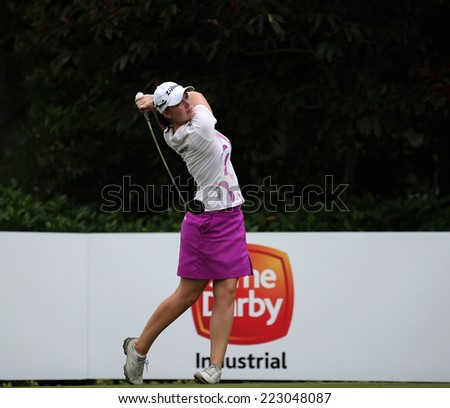 KUALA LUMPUR, MALAYSIA - OCTOBER 11, 2014: Caroline Masson of Germany tees off at the fourth hole of the KL Golf & Country Club during the 2014 Sime Darby LPGA Malaysia got tournament. - stock photo