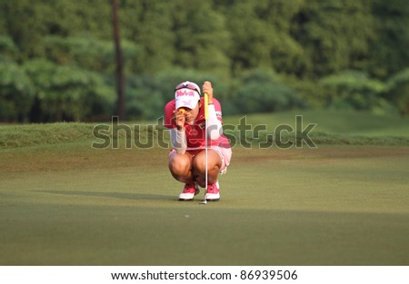 KUALA LUMPUR, MALAYSIA - OCTOBER 16: Chella Choi of South Korea prepares to  putt at hole #3 on day 4 of the Sime Darby LPGA Malaysia 2011 golf tournament on Oct 16, 2011 in Kuala Lumpur, Malaysia. - stock photo