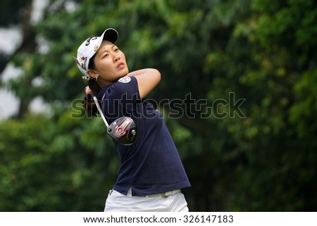 KUALA LUMPUR, MALAYSIA - OCTOBER 10, 2015: China's Xi Yu Lin tees off at the sixth hole of the KL Golf & Country Club on Round 3 day at the 2015 Sime Darby LPGA Malaysia golf tournament. - stock photo