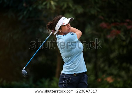 KUALA LUMPUR, MALAYSIA - OCTOBER 11, 2014: Gerina Piller of the USA tees off at the fourth hole of the KL Golf & Country Club during the 2014 Sime Darby LPGA Malaysia golf tournament. - stock photo
