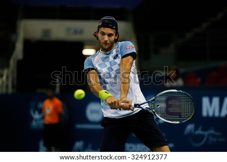 KUALA LUMPUR, MALAYSIA - OCTOBER 01, 2015: Joao Sousa of Portugal attempts a backhand return during his match at the Malaysian Open 2015 Tennis tournament held at the Putra Stadium, Malaysia. - stock photo