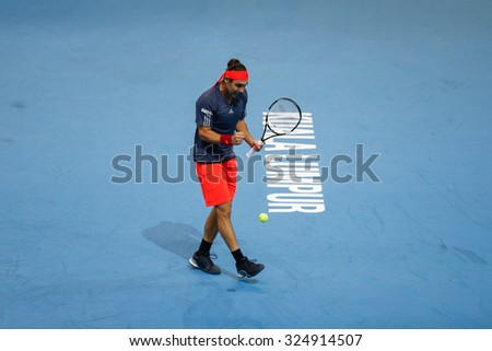 KUALA LUMPUR, MALAYSIA - OCTOBER 01, 2015: Marcos Baghdatis of Cyprus reacts after playing a winner in his match at the Malaysian Open 2015 Tennis tournament held at the Putra Stadium, Malaysia. - stock photo