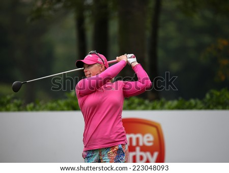 KUALA LUMPUR, MALAYSIA - OCTOBER 11, 2014: Morgan Pressel of the USA tees off at the fourth hole of the KL Golf & Country Club during the 2014 Sime Darby LPGA Malaysia got tournament. - stock photo
