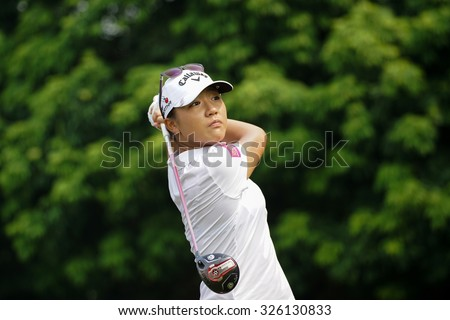 KUALA LUMPUR, MALAYSIA - OCTOBER 10, 2015: New Zealand's Lydia Ko tees off at the sixth hole of the KL Golf & Country Club on Round 3 day at the 2015 Sime Darby LPGA Malaysia golf tournament. - stock photo