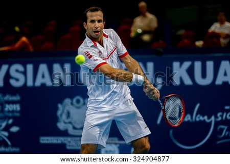 KUALA LUMPUR, MALAYSIA - OCTOBER 01, 2015: Radek Stepanek of the Czech Republic plays a backhand return in his match at the Malaysian Open 2015 Tennis tournament held at the Putra Stadium, Malaysia. - stock photo