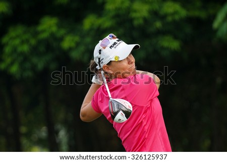 KUALA LUMPUR, MALAYSIA - OCTOBER 10, 2015: South Africa's Lee-Anne pace tees off at the sixth hole of the KL Golf & Country Club on Round 3 day at the 2015 Sime Darby LPGA Malaysia golf tournament. - stock photo