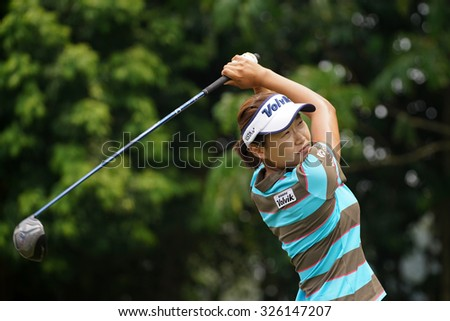 KUALA LUMPUR, MALAYSIA - OCTOBER 10, 2015: South Korea's Ilhee Lee tees off at the sixth hole of the KL Golf & Country Club on Round 3 day at the 2015 Sime Darby LPGA Malaysia golf tournament.  - stock photo